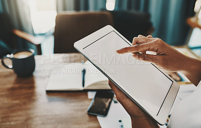 Buy stock photo Cropped shot of a businesswoman using a digital tablet while working in her home office
