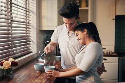 Buy stock photo Cropped shot of a young couple pouring their morning coffee