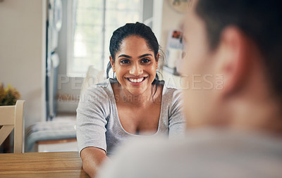 Buy stock photo Shot of a young woman sitting at home with her boyfriend