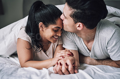 Buy stock photo Cropped shot of an affectionate couple lying in bed