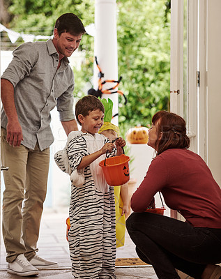 Buy stock photo Shot of two adorable little boys celebrating halloween with their parents at home