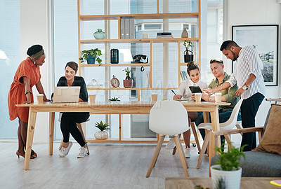 Buy stock photo Full length shot of a diverse group of business colleagues working on technology in the office