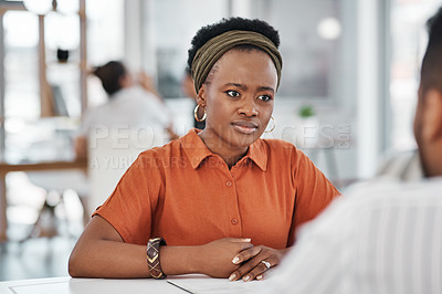 Buy stock photo Cropped shot of an attractive young businesswoman sitting and having a discussion with a colleague in the office
