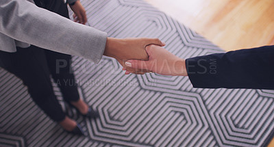 Buy stock photo High angle shot of an unrecognizable female financial advisor shaking hands with a client in her office during the day