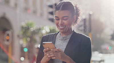 Buy stock photo Cropped shot of an attractive young businesswoman smiling while using a smartphone outdoors in the city