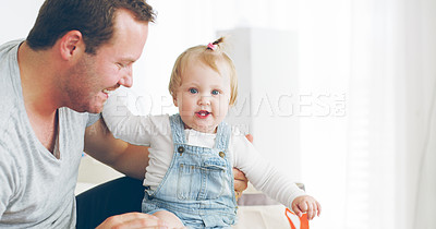 Buy stock photo Cropped shot of an affectionate young father spending time with his baby girl at home