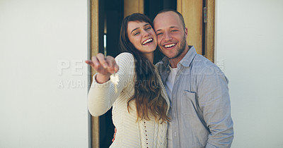 Buy stock photo Cropped portrait of an affectionate young couple showing off the keys to their new home outdoors