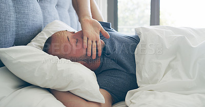 Buy stock photo Cropped shot of a handsome young man waking up from a nap in his bedroom at home