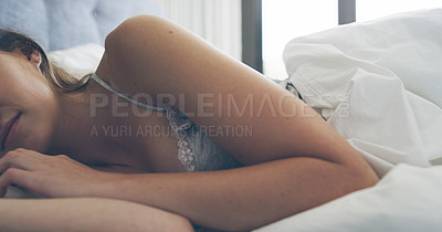 Buy stock photo Cropped shot of an unrecognizable young woman sleeping peacefully in her bedroom at home