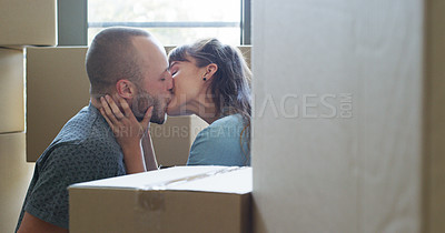 Buy stock photo Cropped shot of an affectionate young couple kissing in their new home on moving day