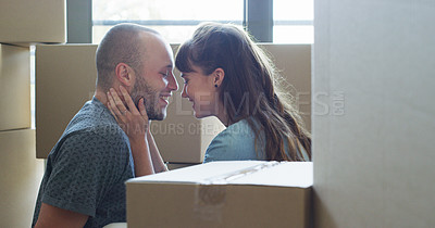 Buy stock photo Cropped shot of an affectionate young couple sharing an intimate moment together in their new home on moving day