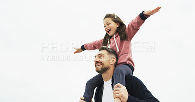 Buy stock photo Shot of a father carrying his little daughter on his shoulders outdoors