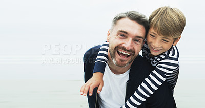 Buy stock photo Portrait of a father giving his son a piggyback ride outdoors
