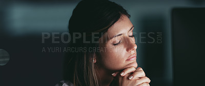 Buy stock photo Shot of a young businesswoman sleeping while working in an office at night