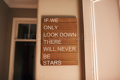 Buy stock photo Shot of a motivational quote hanging on a wall