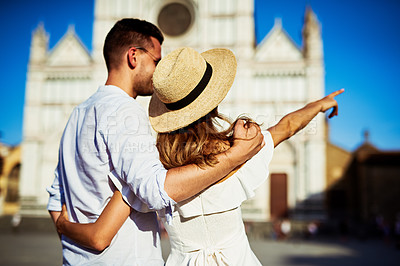 Buy stock photo Shot of a happy young couple sightseeing in the city of Florence