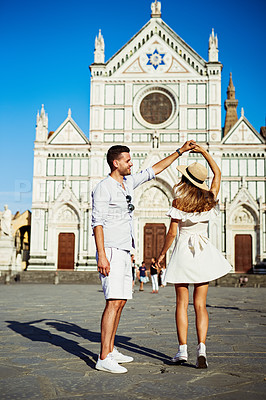 Buy stock photo Shot of a happy young couple dancing in the city of Florence
