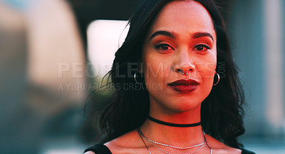 Buy stock photo Cropped shot of a young woman out in the city at night