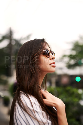 Buy stock photo Cropped shot of an attractive young woman standing outdoors during the day
