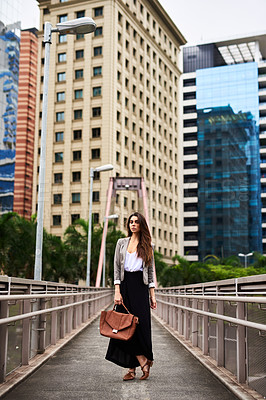 Buy stock photo Full length portrait of an attractive young woman standing outdoors in the city during the day