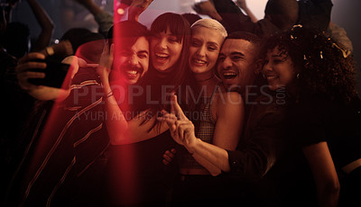 Buy stock photo Cropped shot of a diverse group of young friends taking a selfie together while partying in a nightclub