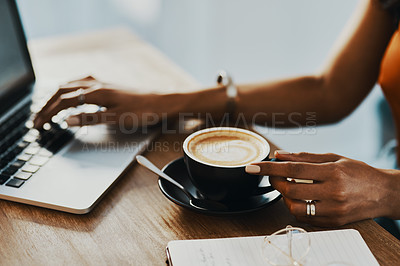 Buy stock photo Cropped shot of a woman having coffee while working at home