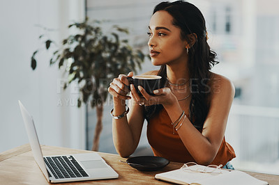 Buy stock photo Shot of a young woman having a coffee break while working at home