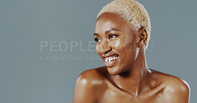 Buy stock photo Cropped shot of an attractive young woman standing alone and smiling against a gray background in the studio