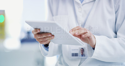 Buy stock photo Closeup shot of a scientist using a digital tablet in a lab