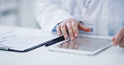 Buy stock photo Closeup shot of a scientist using a clipboard and digital tablet in a lab