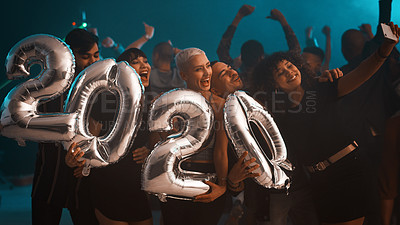 Buy stock photo Cropped shot of a group of young friends taking a selfie together while holding balloons that read