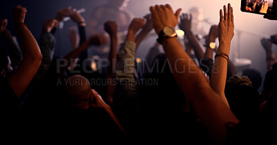 Buy stock photo Cropped shot of an unrecognizable crowd enjoying a performance at a concert in a nightclub