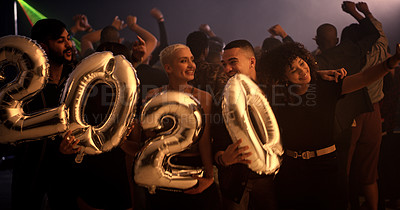 Buy stock photo Cropped shot of a group of young friends holding up balloons that read