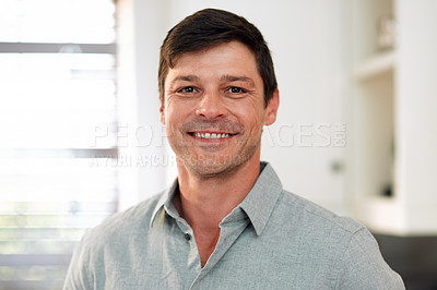 Buy stock photo Closeup shot of a man smiling while spending the day indoors