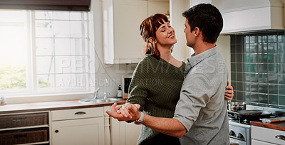 Buy stock photo Cropped shot of a happy couple slow dancing at home