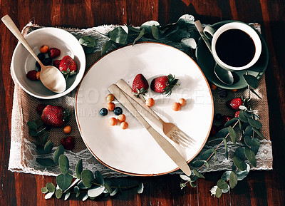 Buy stock photo High angle shot of a neatly organised tray with coffee; berries on a plate and in a bowl