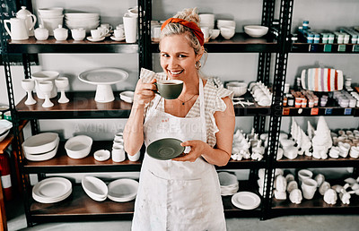 Buy stock photo Cropped portrait of an attractive mature woman standing alone and holding a cup of coffee in her pottery workshop