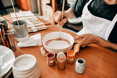 Buy stock photo Cropped shot of an unrecognizable woman sitting alone and painting a pottery bowl in her workshop