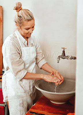 Buy stock photo Cropped shot of a artisan woman washing her hands