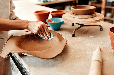Buy stock photo Cropped shot of an unrecognizable artisan working in a pottery workshop