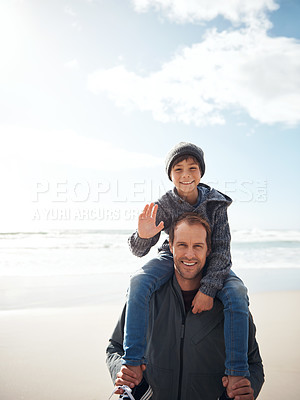 Buy stock photo Cropped portrait a handsome young man carrying his son on his shoulders while bonding on the beach