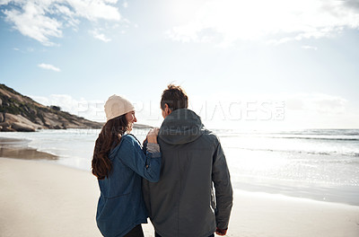Buy stock photo Cropped shot of an unrecognizable woman standing with her husband during a day out on the beach