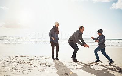 Buy stock photo Full length shot of a happy young boy running to his parents during a day out on the beach