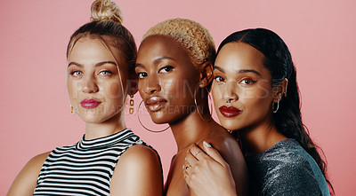 Buy stock photo Studio portrait of a diverse group of beautiful young women posing against a pink background