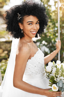 Buy stock photo Portrait of a happy and beautiful young bride holding a bouquet of flowers while posing outdoors on her wedding day