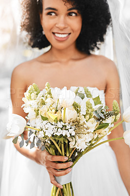 Buy stock photo Shot of a happy and beautiful young bride holding a bouquet of flowers while posing outdoors on her wedding day