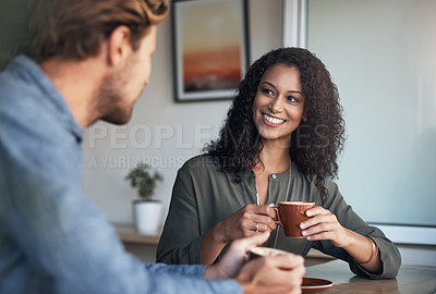Buy stock photo Shot of a young couple having coffee together in a cafe
