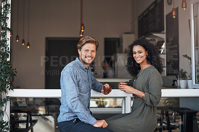 Buy stock photo Portrait of a young couple having coffee together in a cafe