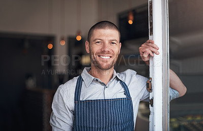 Buy stock photo Portrait of a mature man standing at the doorway of his cafe