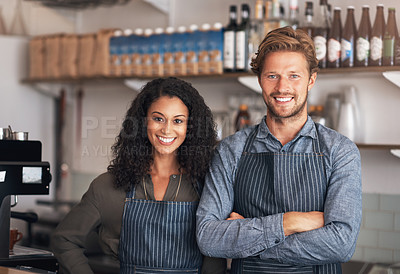 Buy stock photo Portrait of a young man and woman working in a cafe